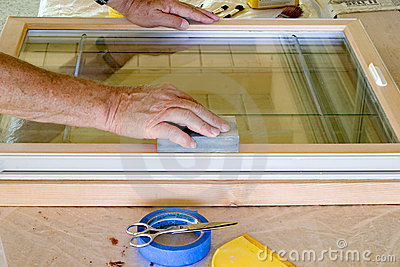 Man Sanding Window Frame