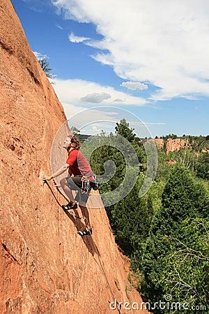 Man sandstone rock climbing