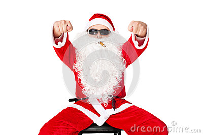 Man in Santa Claus clothes shows fig