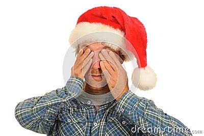 Man in Santa hat covering eyes