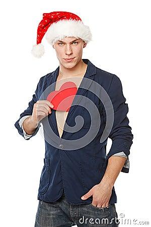 Man in Santa hat pulling out a heart shape