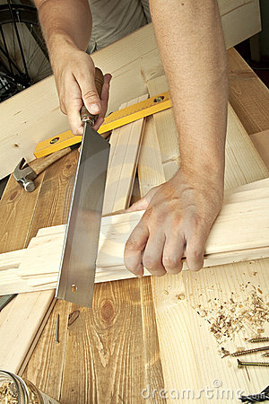 Man sawing plank