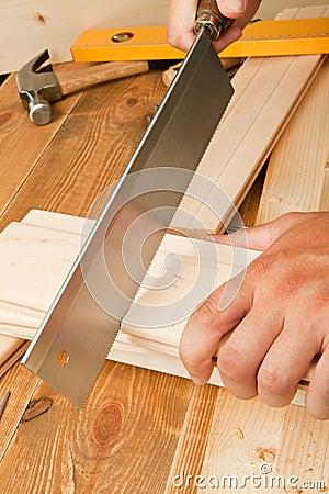 Man sawing plank
