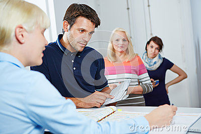 Man scheduling appointment with doctors assistant