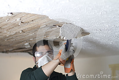 Scraping Ceiling Close Up
