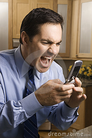 Man screaming at cellphone