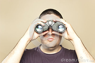 Man searches with binoculars