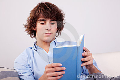 Man seated reading a book