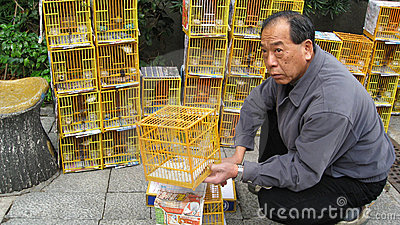 Man Selling Birds at Hong Kong Bird Market Editorial Photo