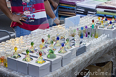 Vendor selling perfume in colorful bottles Editorial Stock Photo