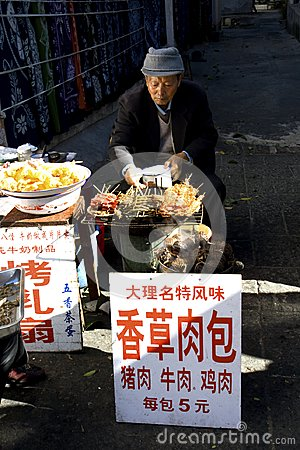 Free Man Selling Food Along Street Stock Photography - 108951612