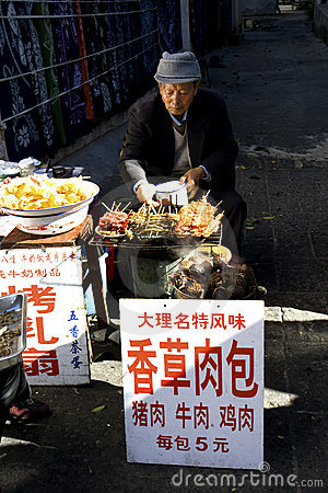 Man selling food along street Editorial Stock Image
