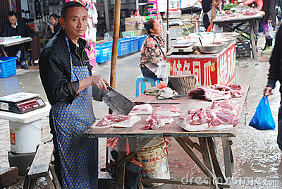 Man selling pork Editorial Stock Photo