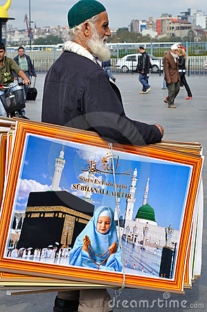 Man selling religious artwork Editorial Stock Image