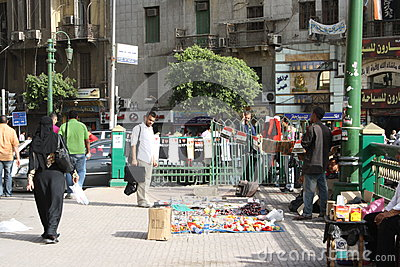 A man selling revolution souvenirs in cairo egypt Editorial Stock Image