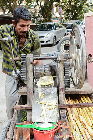 Free Man Selling Sugarcane Juice Stock Photography - 71396042