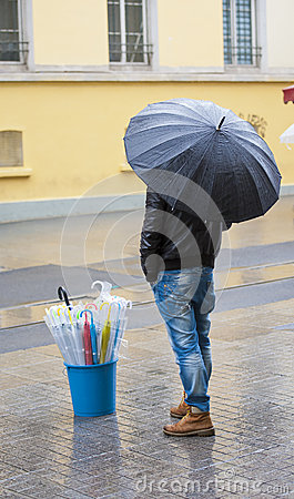 Free Man Selling Umbrellas Stood In Street Royalty Free Stock Images - 35236199