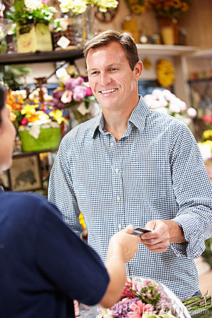 Man serving customer in florist