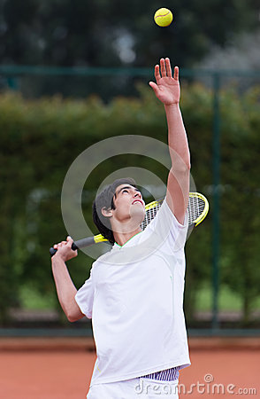 Man serving at tennis