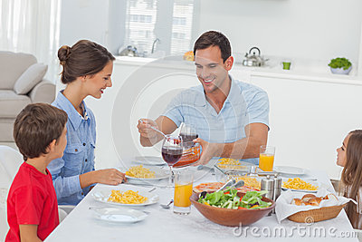 Man serving wife during the dinner