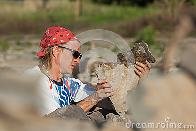 Man Setting Up Stone Pile Editorial Stock Photo