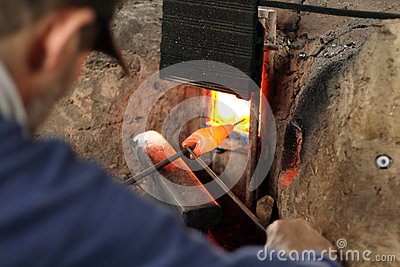 A man shaping a glass bead