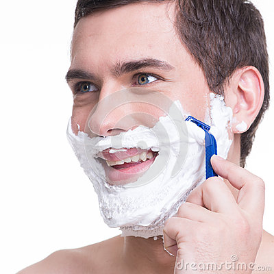 man shaving the  beard with the razor