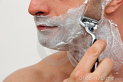 Man shaving his beard