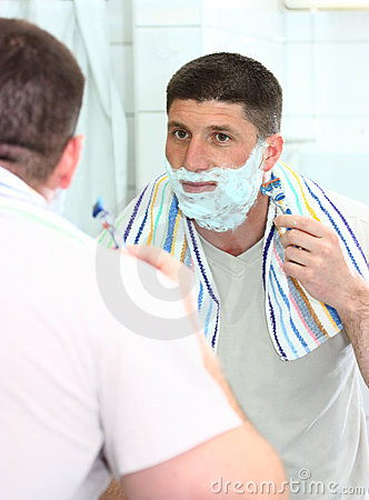 A man shaving his beard