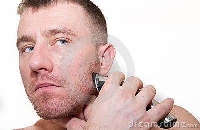 A Man Shaving His Face