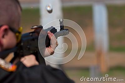 Man shooting.
