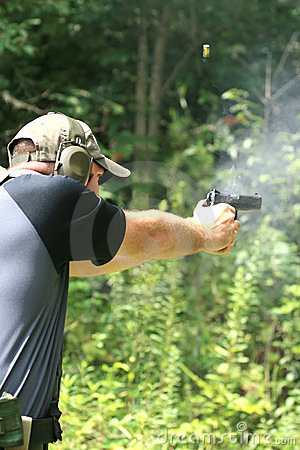 Free Man Shooting Pistol - Sideview Stock Images - 2405274
