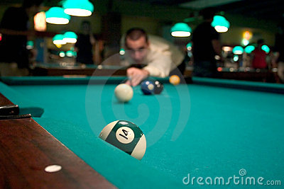 Man shooting pool