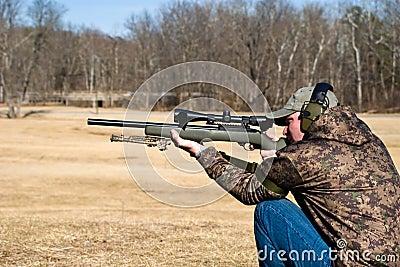 Man Shooting Rifle