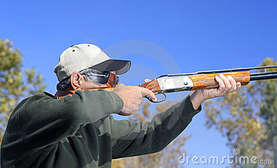 Man Shooting Shotgun