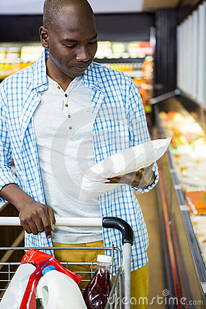 Free Man Shopping In Grocery Section Stock Photos - 77860523