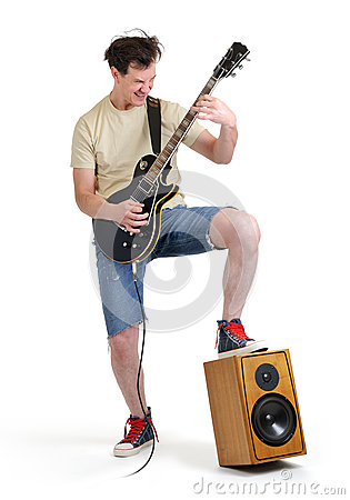 Man in shorts with an electric guitar