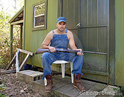 man-shotgun-guarding-his-property-229823