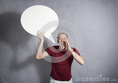 Man shouting  with empty speech ballon in hand.