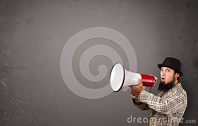 Man shouting into megaphone on copy space background