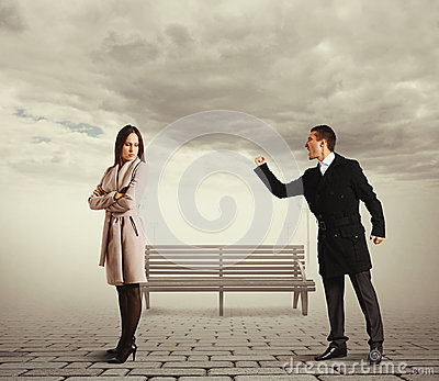 Man shouting at sad woman