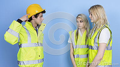 Man Shouting To Female Worker For Not Wearing Hard Hat