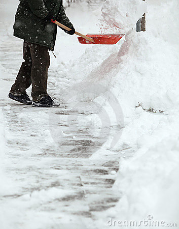 Man shoveling snow from the sidewalk