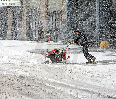 Man shoveling snow during snow storm Editorial Photography