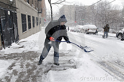 Man shoveling during snow storm in New York Editorial Photo
