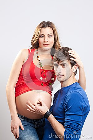 Man show ok sign on pregnant belly