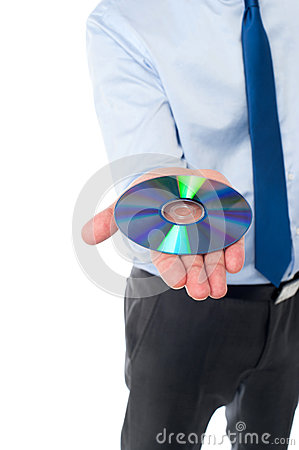 Man showing compact disc, cropped image