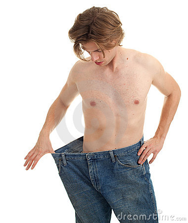 Man showing how much weight he lost