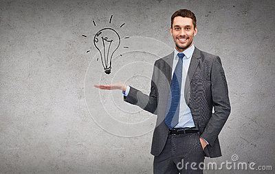 Man showing light bulb on the palm of his hand
