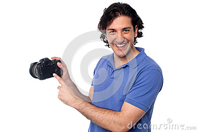 Man showing pictures stored in camera